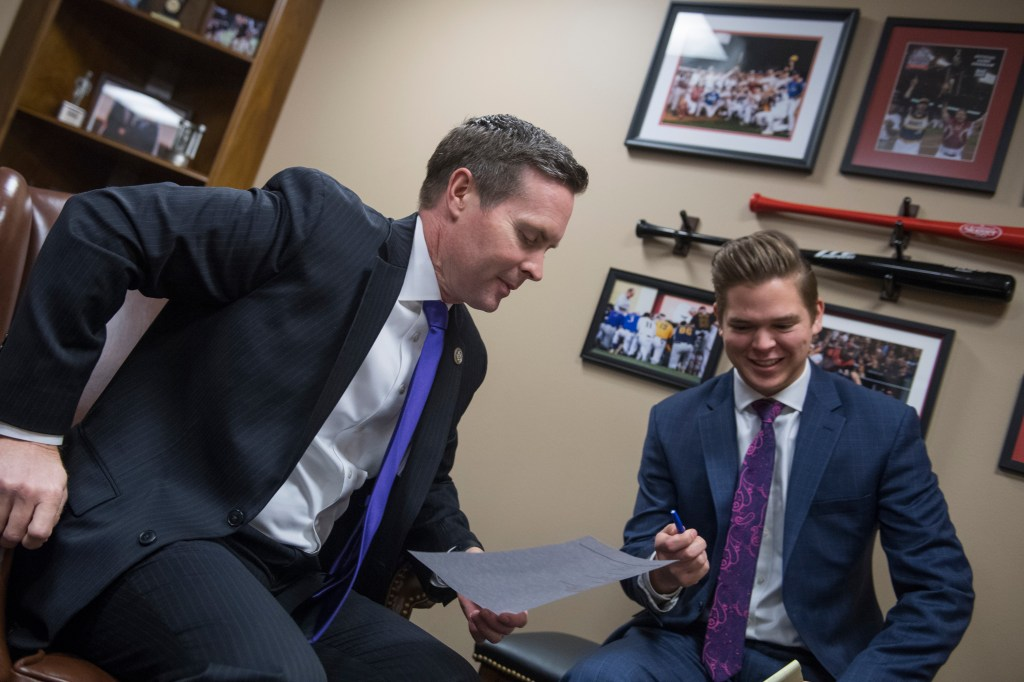 UNITED STATES - FEBRUARY 06: Rep. Rodney Davis, R-Ill., left, and his legislative correspondent David Ross, are seen in their Longworth Building office on February 6, 2018. (Photo By Tom Williams/CQ Roll Call)