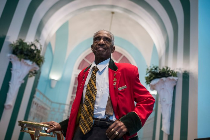 UNITED STATES - FEBRUARY 01: Frank Mosley, 85, poses for a picture shortly after President Donald Trump addressed a luncheon at the House and Senate Republican retreat at The Greenbrier resort in White Sulphur Springs, W.Va., on February 1, 2018. Mosley has worked at The Greenbrier since 1958. (Photo By Tom Williams/CQ Roll Call)