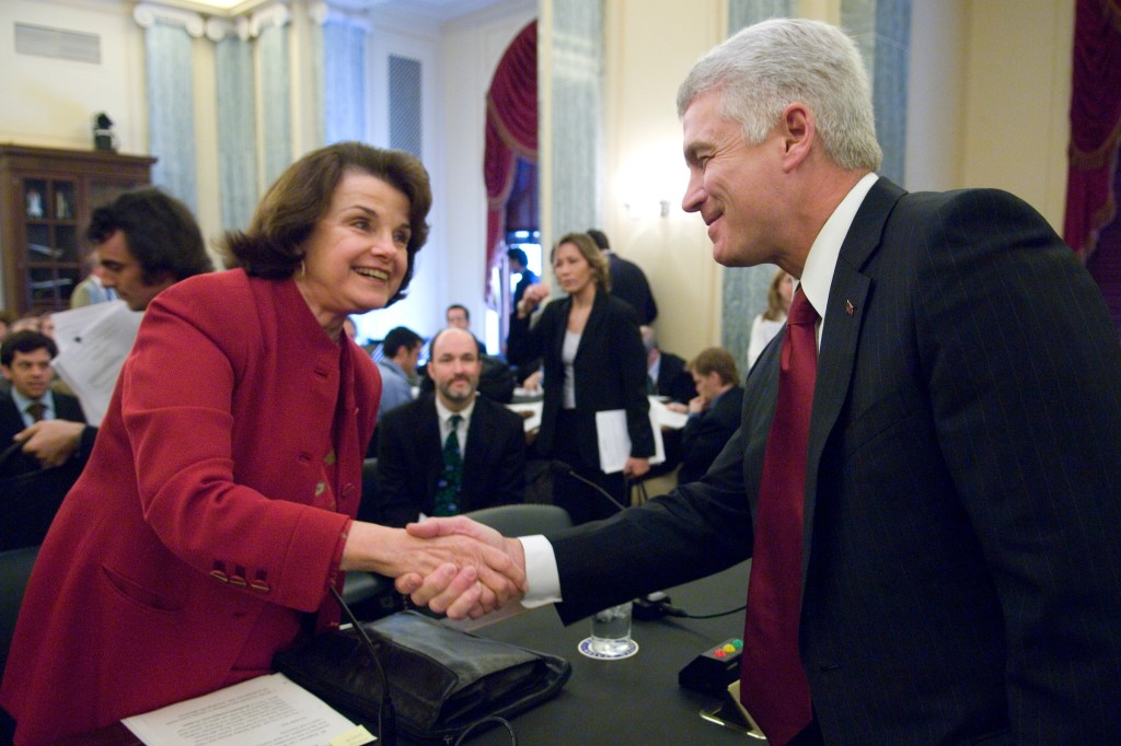 David McCurdy, president of the Alliance of Automobile Manufacturers, shakes hands with Sen. Dianne Feinstein, D-Calif., before the start of the Senate Commerce, Science and Transportation Committee hearing on the
