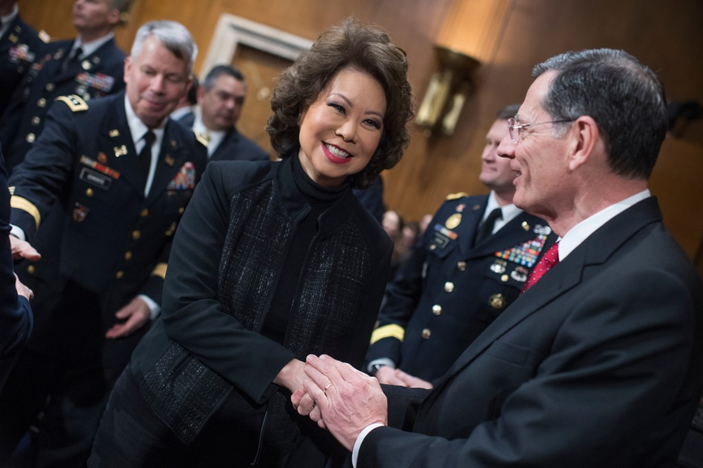 UNITED STATES - MARCH 01: Transportation Secretary Elaine Chao greets Chairman John Barrasso, R-Wyo., before a Senate Environment and Public Works Senate Committee hearing in Dirksen Building titled