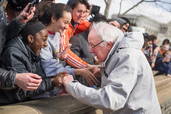 UNITED STATES - MARCH 14: Sen. Bernie Sanders, I-Vt., greets demonstrators while attending a rally on the West Front of the Capitol to call on Congress to act on gun violence prevention during a national walkout by students on March 14, 2018. (Photo By Tom Williams/CQ Roll Call)