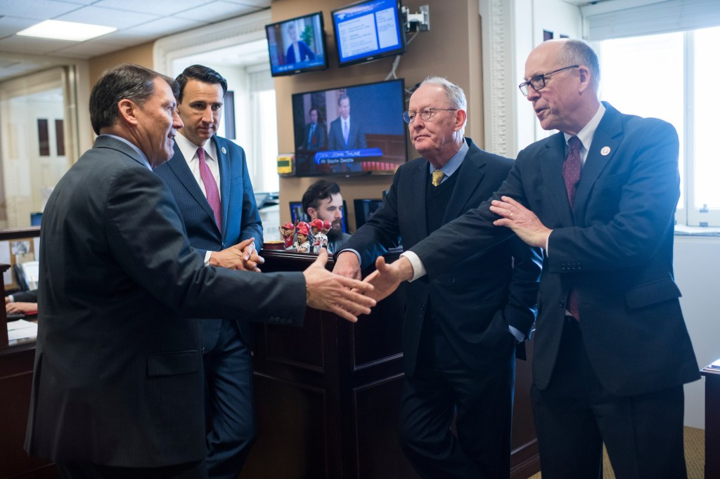 UNITED STATES - MARCH 21: From left, Sen. Mike Rounds, R-S.D., Rep. Ryan Costello, R-Pa., Sen. Lamar Alexander, R-Tenn., and Rep. Greg Walden, R-Ore., prepare for a news conference in the Capitol on legislation to lower health insurance premiums for citizens who pay out of pocket on March 21, 2018.(Photo By Tom Williams/CQ Roll Call)
