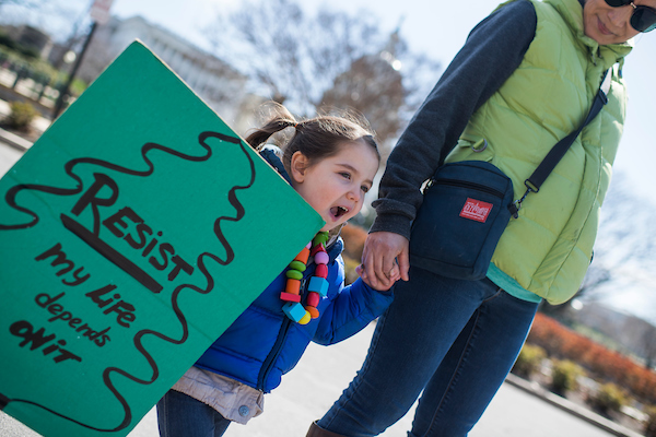 Sybil Ory, 3, of Capitol Hill, makes her way to student-led March for Our Lives rally on Pennsylvania Avenue to call for action to prevent gun violence on. (Tom Williams/CQ Roll Call