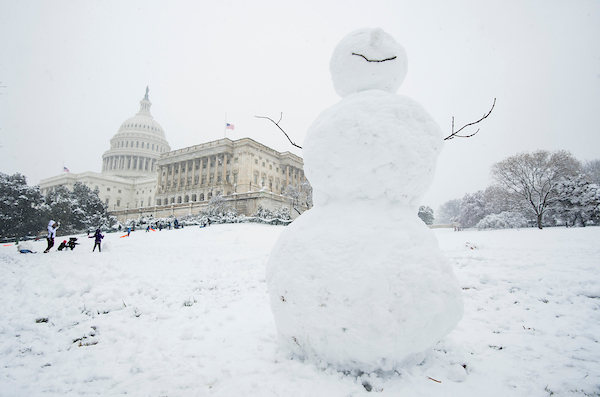 A more-than-six-foot tall snowman stands on the west side of the Capitol. (Bill Clark/CQ Roll Call)