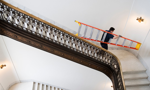 UNITED STATES - MARCH 12: A Capitol worker carries a ladder down the stairs in the Russell Senate Office Building on Monday, March 12, 2018. (Photo By Bill Clark/CQ Roll Call)
