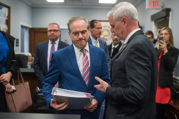 UNITED STATES - MARCH 15: David Shulkin, left, Secretary of Veterans Affairs, talks with Rep. Steve Womack, R-Ark., before a House Appropriations Military Construction, Veterans Affairs and Related Agencies subcommittee hearing in Rayburn Building on the department's FY2019 budget on March 15, 2018. (Photo By Tom Williams/CQ Roll Call)