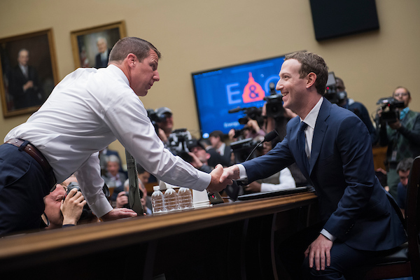 UNITED STATES - APRIL 11: Facebook CEO Mark Zuckerberg, right, talks with Rep. Markwayne Mullin, R-Okla., before Zuckerberg testified before a House Energy and Commerce Committee in Rayburn Building on the protection of user data on April 11, 2018. (Photo By Tom Williams/CQ Roll Call)