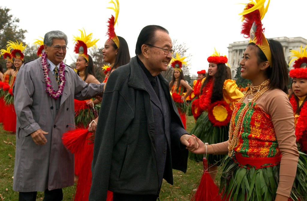 Sens. Daniel Inouye,D-Hawaii, center, and Daniel Akaka, D-D-Hawaii, greet members of the Hawaii All State Marching Band composed of students from 40 high schools and 4 islands from Hawaii, after they performed on the West Front, in preparation for the Macy's Thanksgiving Day Parade, in New York.