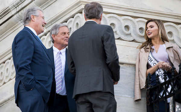 UNITED STATES - APRIL 18: From left, Rep. Rick Allen, R-Ga., Rep. Ralph Norman, R-S.C., and Rep. Brian Babin, R-Texas, stop to chat with Miss South Carolina Tori Sizemore as they arrive at the Capitol for the final votes of the week on Wednesday, April 18, 2018. Several Miss USA pageant contestants were on the House steps to pose for an earlier photo with Rep. Robert Aderholt, R-Ala., (Photo By Bill Clark/CQ Roll Call)