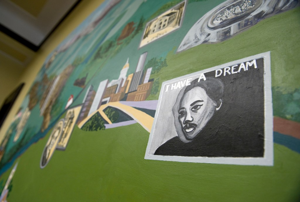 A mural created by middle school students from Cobb County, Ga., depicting regions of Georgia hangs in the office of Sen. Johnny Isakson, R-Ga., March 17, 2009. This image shows Martin Luther King Jr., outside Atlanta.