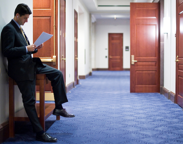 Ryan looks over papers as he waits for other House Republicans to arrive for a news conference in the Capitol Visitors Center in January 2010. (CQ Roll Call archive photo)