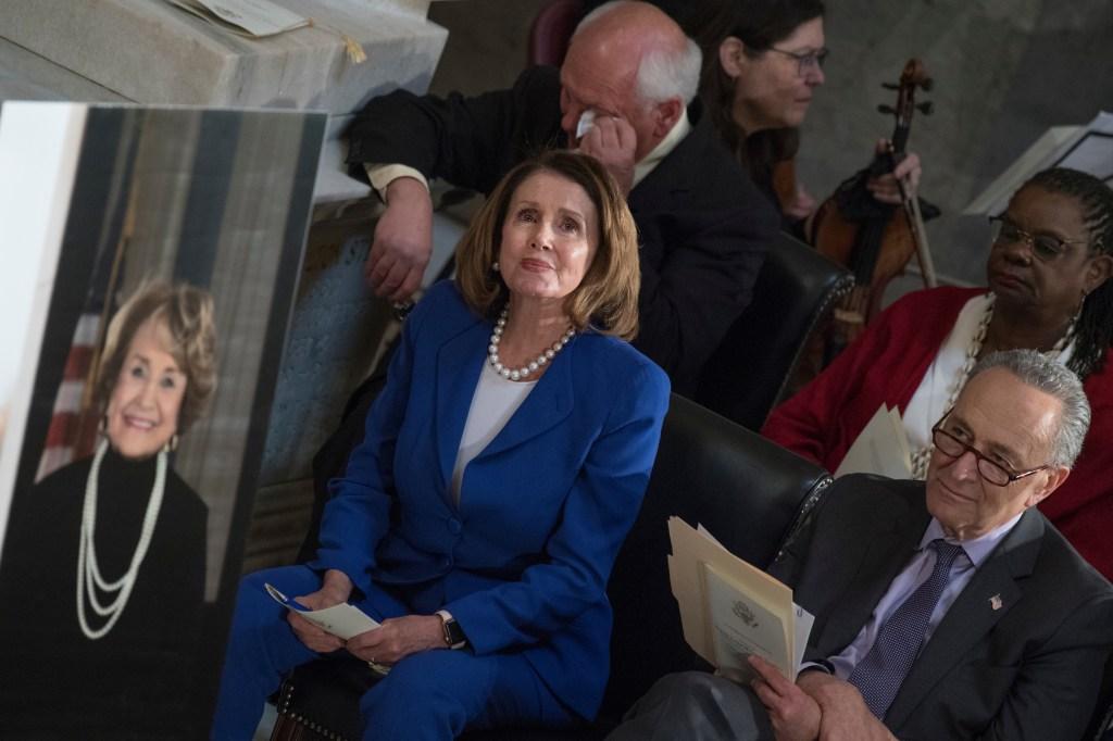 House Minority Leader Nancy Pelosi, D-Calif., center, Senate Minority Leader Charles Schumer, D-N.Y., right, Reps. Gwen Moore, D-Wis., and Paul Tonko, D-N.Y., listen to rendition of