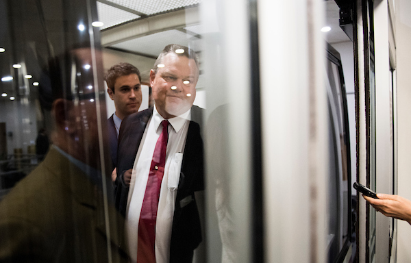 UNITED STATES - APRIL 24: Sen. Jon Tester, D-Mont., speaks with reporters as he boards the Senate subway in the Capitol on Tuesday, April 24, 2018. (Photo By Bill Clark/CQ Roll Call)