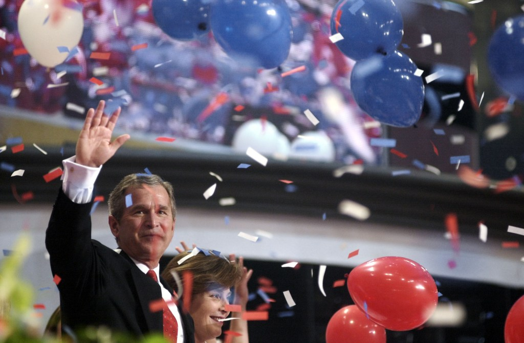 GOPconvention12(TW)080300 -- Gov. George W. Bush, R-Texas, and wife Laura after his acceptance to the GOP Presidential nomonation at the First Union Center in Philadelphia, Pa.