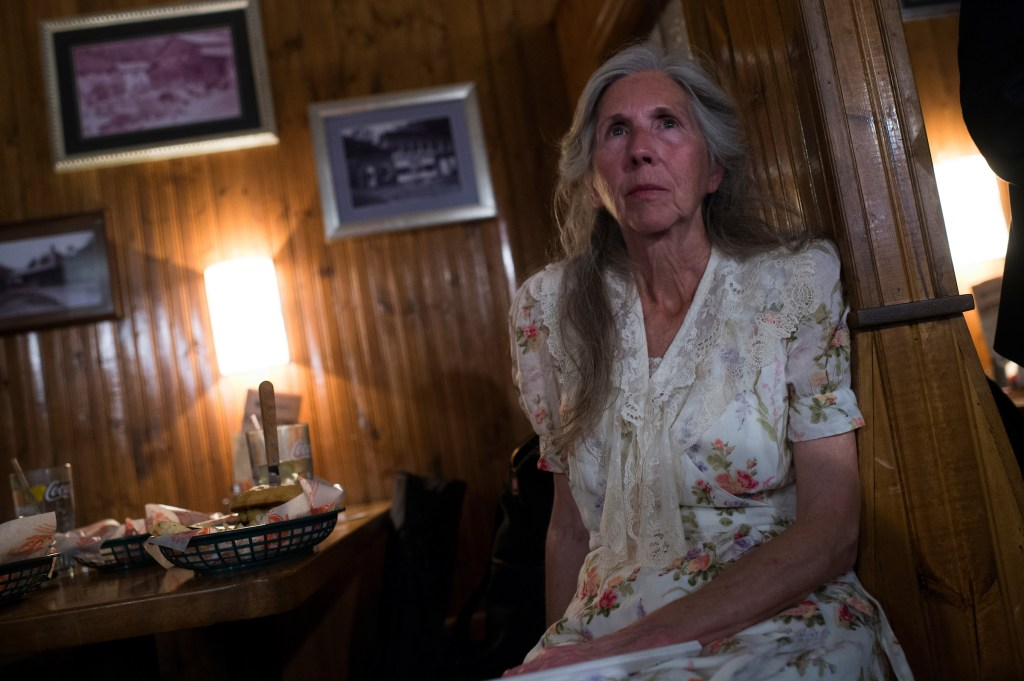Gwen Thomas, whose brother Grover Skeens was killed in the Upper Big Branch mine explosion in 2010, listens to Don Blankenship, who is running for the Republican nomination for Senate in West Virginia, conduct a town hall meeting at Macado's restaurant in Bluefield, W.Va., on May 3, 2018. Blankenship was the CEO of Massey Energy which owned the mine and he spent a year in prison for charges relating to the disaster. (Photo By Tom Williams/CQ Roll Call)