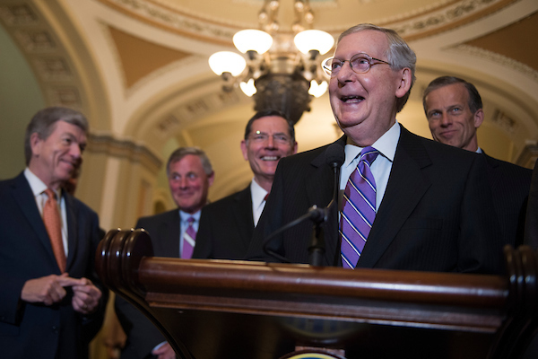 UNITED STATES - MAY 8: Senate Majority Leader Mitch McConnell cracks a smile as he speaks to the press after the Senate Republican Policy luncheon in the Capitol on May 8, 2018. (Photo By Sarah Silbiger/CQ Roll Call)