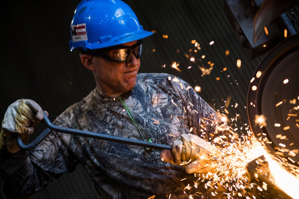 UNITED STATES - MAY 2: Tim Shea grinds a hook bar at Warwood Tool Company in Wheeling, W.Va., on May 2, 2018. Rep. Evan Jenkins, R-W.Va., who is running for the Republican nomination for Senate in West Virginia, was at the plant for a tour. (Photo By Tom Williams/CQ Roll Call)