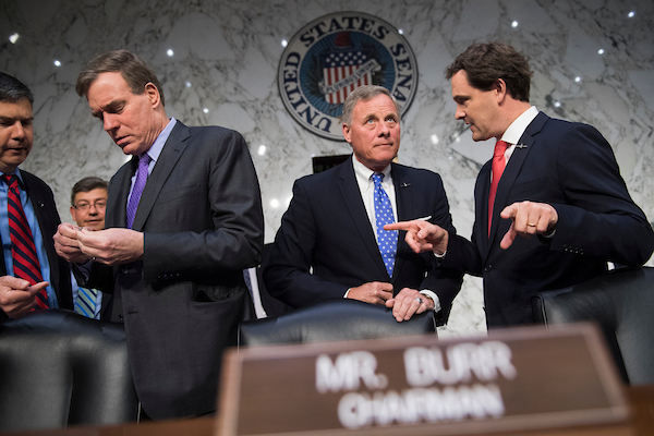UNITED STATES - MAY 9: Chairman Richard Burr, R-N.C., center, and ranking member Sen. Mark Warner, D-Va., third from left, arrive for the Senate (Select) Intelligence Committee confirmation hearing for Gina Haspel, nominee to be director of the CIA, in Hart Building on May 9, 2018. (Photo By Tom Williams/CQ Roll Call)