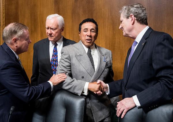 UNITED STATES - MAY 15: From left, Sen. Lindsey Graham, R-S.C., Sen. Orrin Hatch, R-Utah, recording artist Smokey Robinson, and Sen. John Kennedy, R-La., talk before the start of the Senate Judiciary Committee hearing on