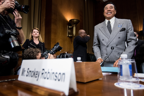 UNITED STATES - MAY 15: Recording artist Smokey Robinson takes his seat at the witness table for the Senate Judiciary Committee hearing on