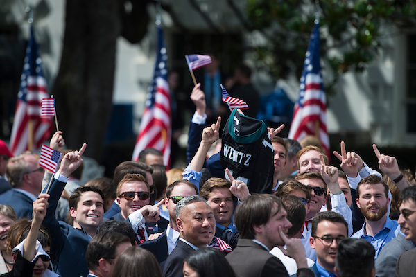 A group of attendees at the Celebration of America event on the South Lawn of the White House hold up a Philadelphia Eagles jersey Tuesday afternoon June 5, 2018.