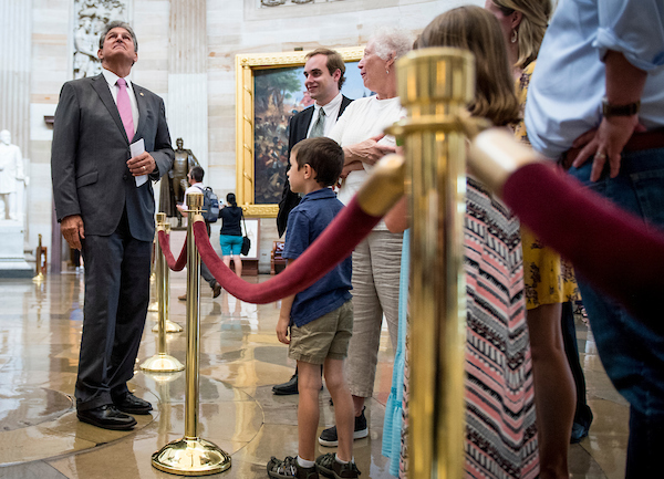 Sen. Joe Manchin, R-Wa.V., speaks to tourists while showing his grandson around the Capitol Thursday June 21, 2018. (Photo By Sarah Silbiger/CQ Roll Call)