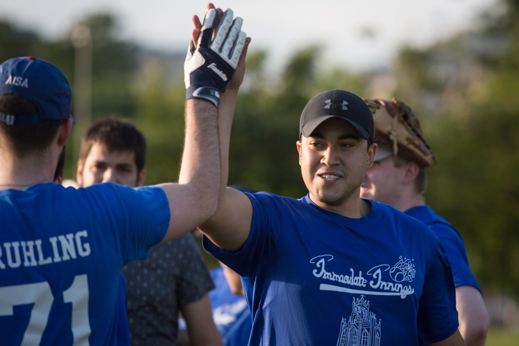 Players on the Immaculate Innings House softball league team high five during their game against the Tax Dodgers. The Tax Dodgers beat Immaculate Innings, 12-11. (Sarah Silbiger/CQ Roll Call)