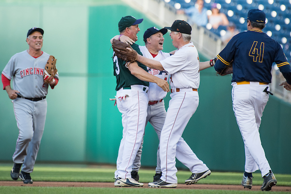 UNITED STATES - JUNE 14: House Majority Whip Steve Scalise, R- La., is congratulated by teammates after throwing out the first runner of the night during the 57th annual Congressional Baseball Game at Nationals Park on June 14, 2018. Scalise was critically wounded in last year's Republican baseball practice shooting. Appearing from left, are Reps. Brad Wenstrup, R-Ohio, Jeff Duncan, R-S.C., Scalise, Mo Brooks, R-Ala., and Mark Walker, R-N.C. The Democrats prevailed 21-5. (Photo By Tom Williams/CQ Roll Call)