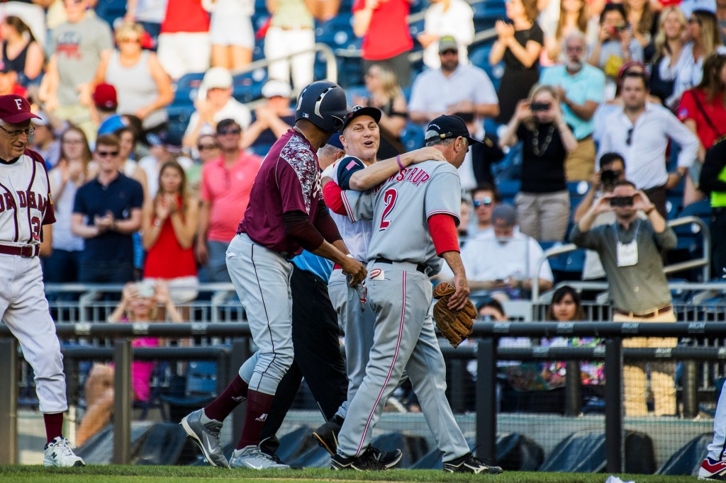 House Majority Whip Steve Scalise, R- La., is helped off the field by teammates after throwing out the first runner of the night during the 57th annual Congressional Baseball Game at Nationals Park on June 14, 2018. Scalise was critically wounded in last year's Republican baseball practice shooting. (Photo By Tom Williams/CQ Roll Call)