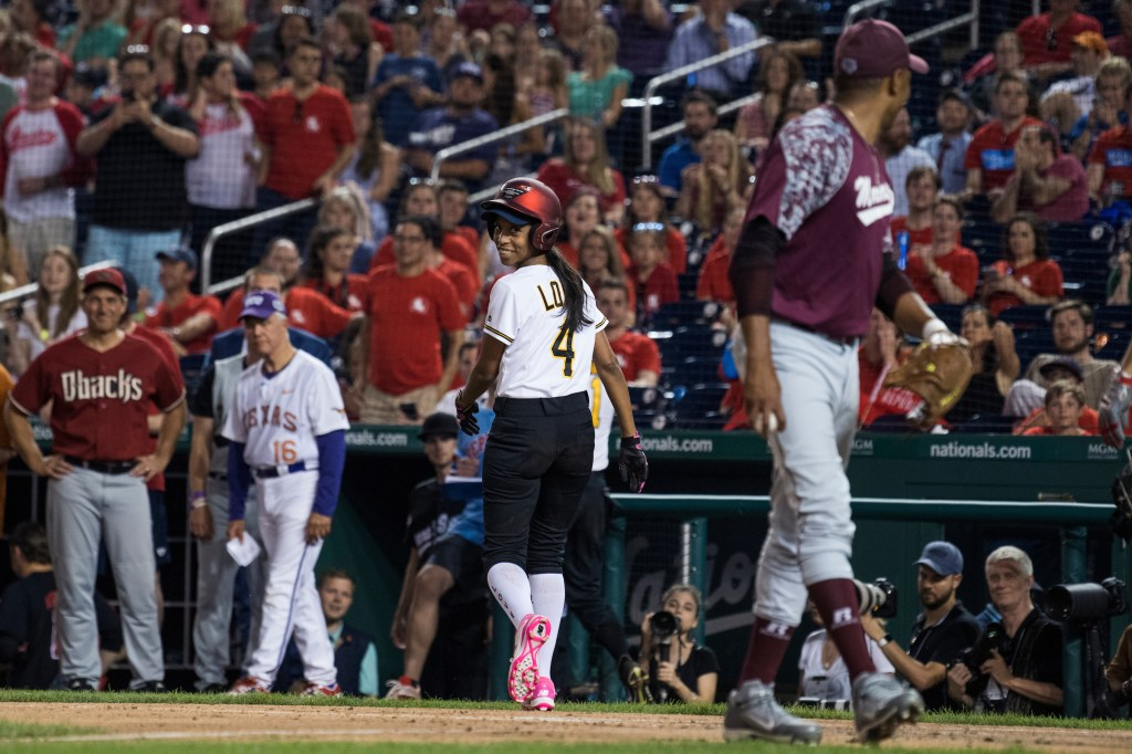 UNITED STATES - JUNE 14: Rep. Mia Love, R-Utah, has a word with Rep. Cedric Richmond, D-La., after he tagged her out at home plate during the 57th annual Congressional Baseball Game at Nationals Park on June 14, 2018. The Democrats prevailed 21-5. (Photo By Tom Williams/CQ Roll Call)