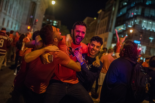 UNITED STATES - JUNE 7: Caps fans celebrate on G Street NW after the Washington Capitals defeated the Vegas Knights 4-3 to capture the team's first Stanley Cup on June 7, 2018. (Photo By Tom Williams/CQ Roll Call)