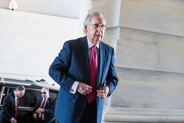 Senate Majority Leader Mitch McConnell, R-Ky., walks to his Capitol office after the Republican Senate Policy luncheon which took place at the National Republican Senatorial Committee on June 12, 2018. (Photo By Tom Williams/CQ Roll Call)