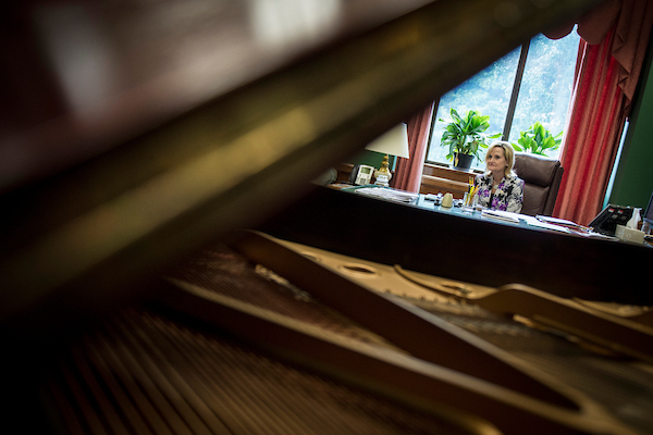 UNITED STATES – JULY 25: Sen. Cindy Hyde-Smith, R-Miss., is seen in her office viewed through former Sen. Thad Cochran's piano in her Dirksen Senate Office Building Wednesday July 25, 2018. Sen. Hyde-Smith took over Cochran's office after his retirement earlier in the year. (Photo By Sarah Silbiger/CQ Roll Call)