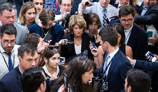 UNITED STATES - JULY 10: Reporters swarm Sen. Lisa Murkowski, R-Alaska, as she arrives for the Senate Republicans' policy lunch in the Capitol on Tuesday, July 10, 2018, the day after President Donald Trump nominated Brett Kavanaugh to the Supreme Court. (Photo By Bill Clark/CQ Roll Call)