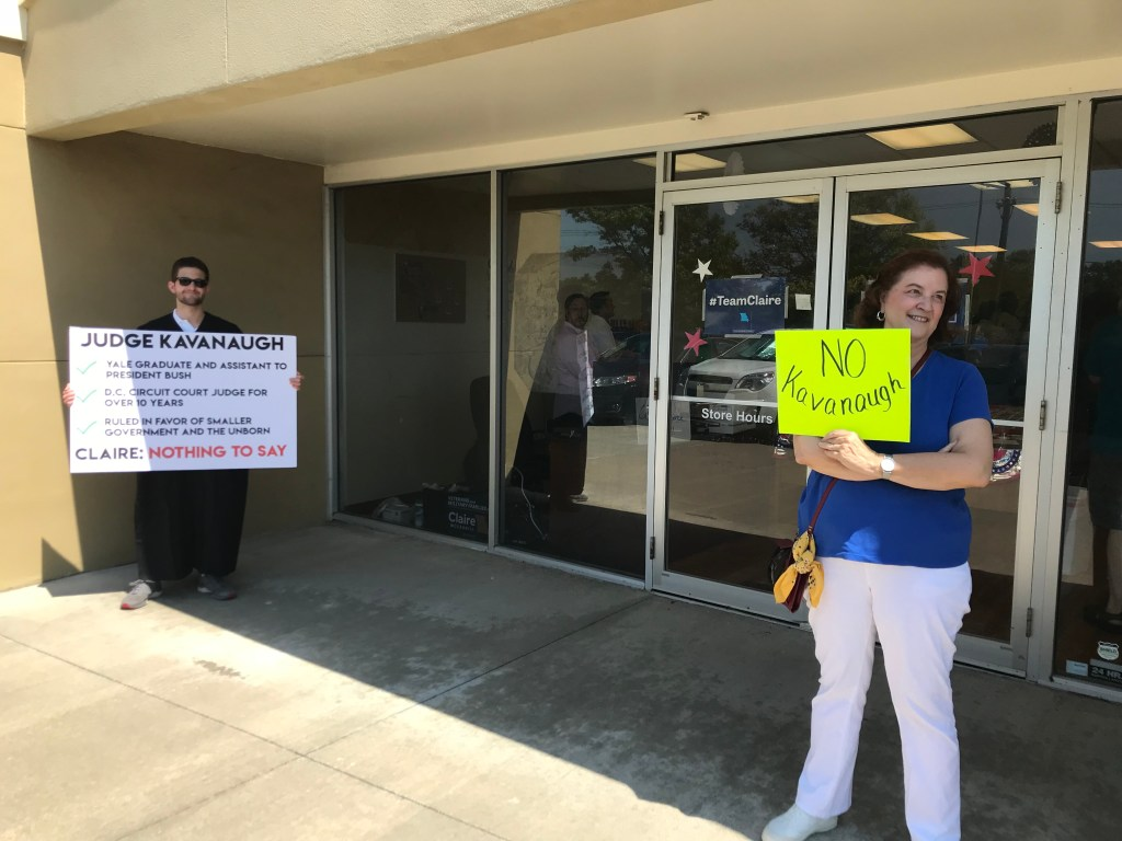 A protester and a volunteer outside of McCaskill's campaign office in Lee's Summit. (Bridget Bowman/CQ Roll Call)