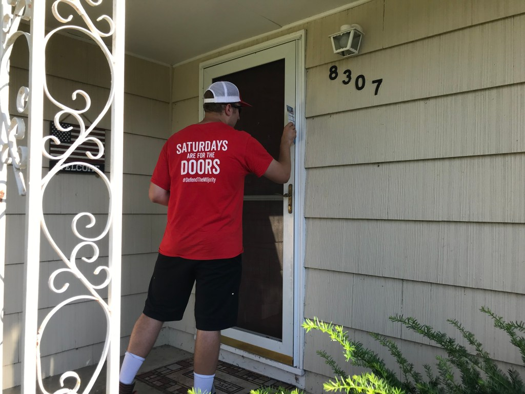 A GOP volunteer knocks on doors in the outskirts of Kansas City. (Bridget Bowman/CQ Roll Call)