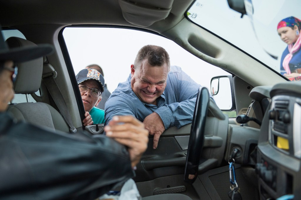 Reach for it! Having never won more than 50 percent of the vote in his previous Senate races, Tester says he isn't taking any vote for granted this year. (Tom Williams/CQ Roll Call).