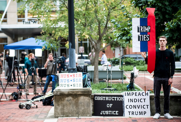 A protester is seen outside of the United States District Court in Alexandria, Virginia where President Donald Trump's former campaign manager Paul Manafort stands trial July 31, 2018. (Photo By Sarah Silbiger/CQ Roll Call)