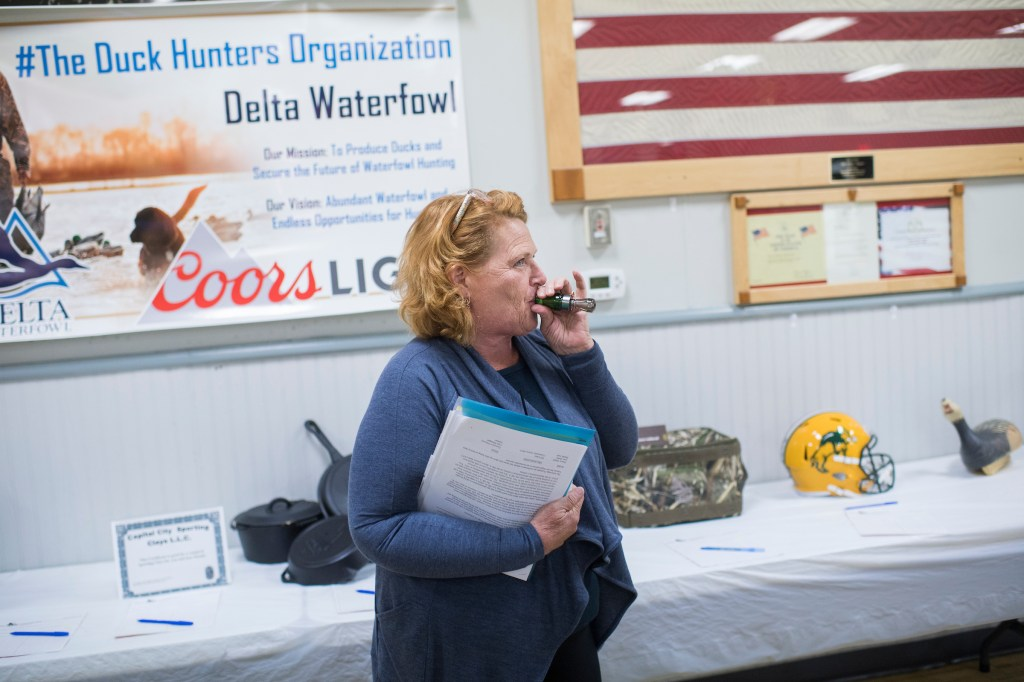 UNITED STATES - AUGUST 17: Sen. Heidi Heitkamp, D-N.D., checks out a duck call at the Amvets Club in Bismarck, N.D., on August 17, 2018. Heitkamp is running against Rep. Kevin Cramer, R-N.D., for the North Dakota Senate seat. (Photo By Tom Williams/CQ Roll Call)