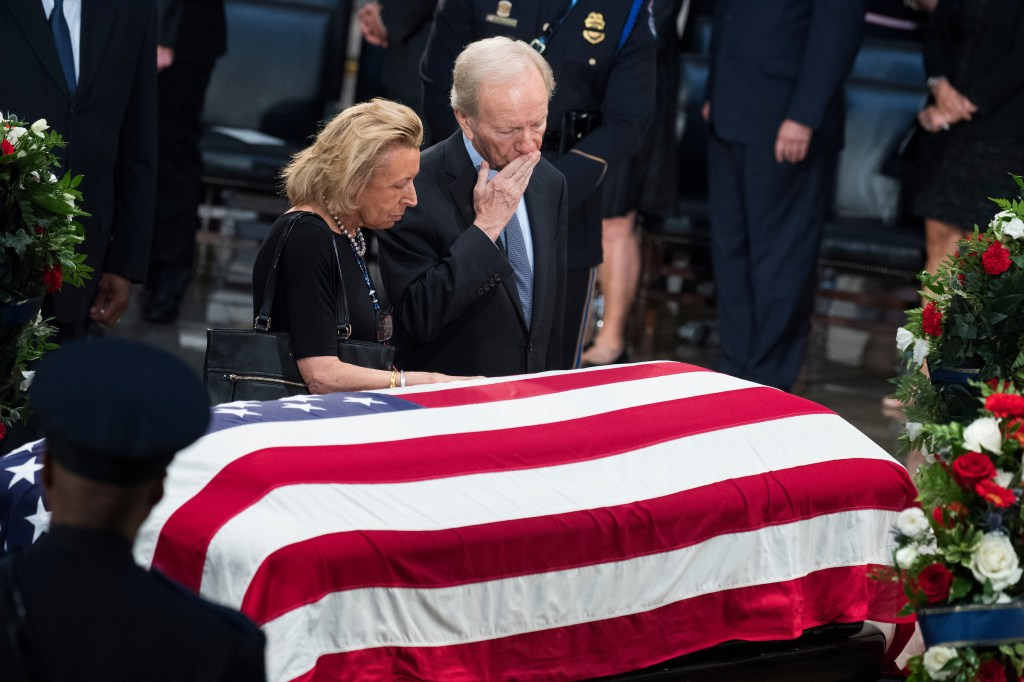 UNITED STATES - AUGUST 31: Former Sen. Joe Lieberman, I-Conn., and his wife Hadassah, pay respects to the late Sen. John McCain, R-Ariz., as the senator lies in state in the Capitol rotunda on August 31, 2018. (Photo By Tom Williams/CQ Roll Call)