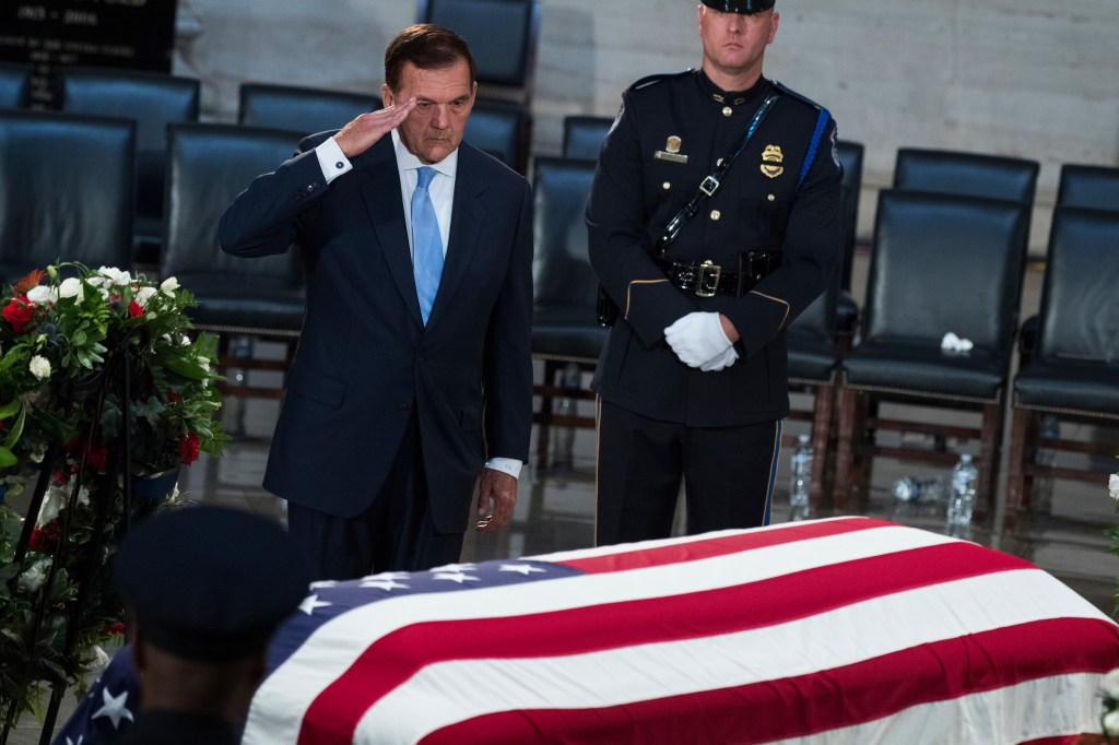 UNITED STATES - AUGUST 31: Tom Ridge, the former secretary of homeland security, pays respect to the late Sen. John McCain, R-Ariz., as the senator lies in state in the Capitol rotunda on August 31, 2018. (Photo By Tom Williams/CQ Roll Call)