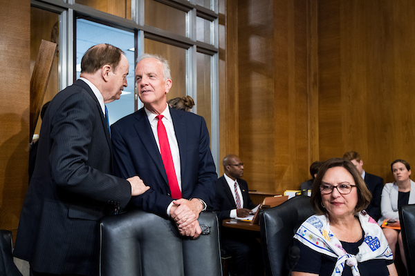 "UNITED STATES - AUGUST 1: From left, Sen. Richard Shelby, R-Ala., Sen. Jerry Moran, R-Kan., and Sen. Deb Fischer, R-Neb., talk before the start testimony from Andrew Wheeler, acting administrator at the Environmental Protection Agency, prepares to testify during the Senate Committee on Environment and Public Works hearing on ""Examining EPA's Agenda: Protecting the Environment and Allowing America's Economy to Grow"" on Wednesday, Aug. 1, 2018. (Photo By Bill Clark/CQ Roll Call)"