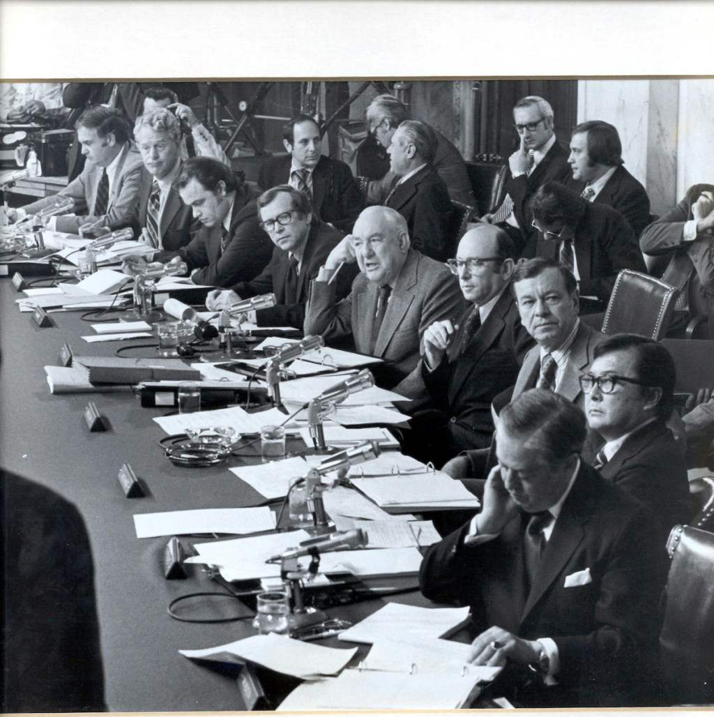 thompsonattic1/040402 -- Senator Thompson serving as Chief Minority Counsel on the Watergate Committee, 1973-1974, Fred Thompson seated third from left Seated from left: Sen. Lowell Weicker (R-CT), Sen. Edward Gurney, (R-FL), Chief Minority Counsel Fred Thompson, Sen. Howard Baker (R-TN), Sen. Sam Ervin (D-NC).(Chairman), Chief Counsel Samuel Dash, Sen. Herman Talmadge (D-GA), Sen. Daniel Inouye (D-HI), Sen. Joseph Montoya (D-NM).