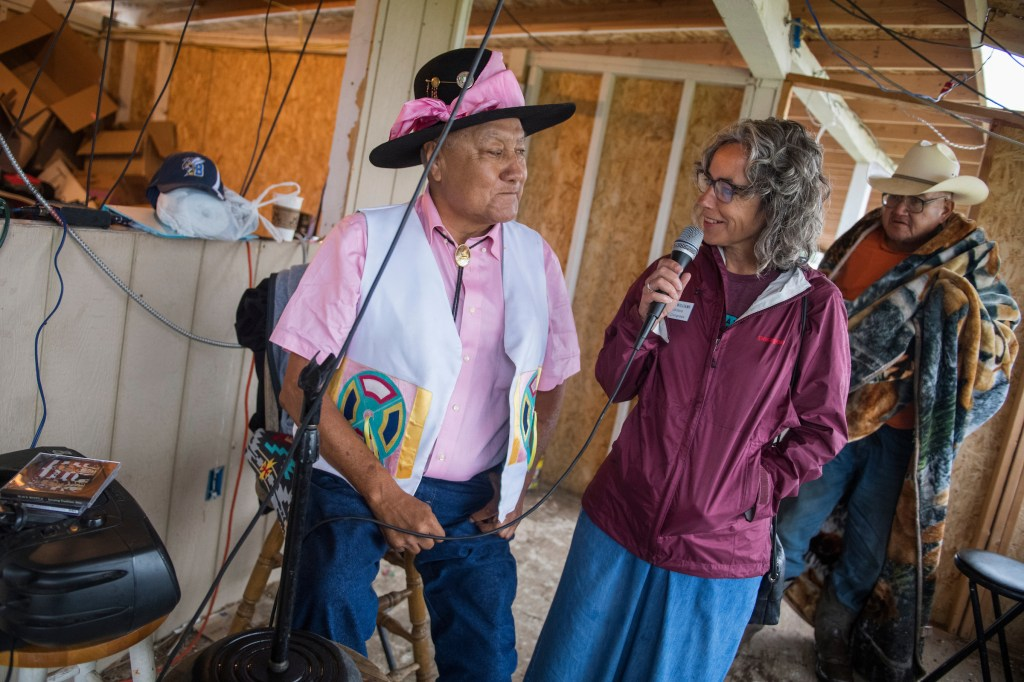 athleen Williams, candidate for Montana's at-large House seat, talks with master of ceremonies Willie Stewart, at the Crow Fair in Crow Agency, Mont., on August 18, 2018. Williams is running against Rep. Greg Gianforte, R-Mont. (Photo By Tom Williams/CQ Roll Call)