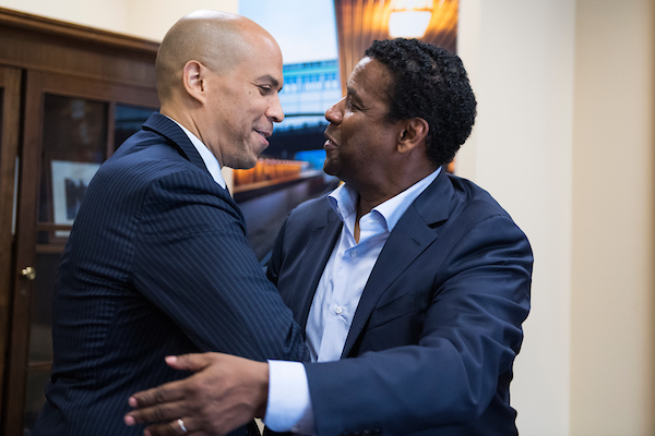 UNITED STATES - SEPTEMBER 25: Denzel Washington, right, meets with Sen. Cory Booker, D-N.J., in Dirksen Building to advocate for the Boys and Girls Clubs of America on September 25, 2018. The organization's National Youth of the Year Celebration is tonight at the National Building Museum. Washington was a member of the Club as a child. (Photo By Tom Williams/CQ Roll Call)