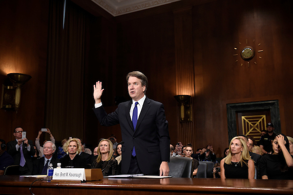 Kavanaugh is sworn in to the Senate Judiciary Committee. (POOL PHOTO/SAUL LOEB/AFP)