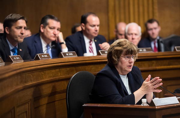 Rachel Mitchell, counsel for Senate Judiciary Committee Republicans, continues her questions of Ford after the panel's first break. Sens. (from left), Ben Sasse, R-Neb., Ted Cruz, R-Texas, Mike Lee, R-Utah, and John Cornyn, R-Texas, listen on. (Tom Williams/CQ Roll Call/POOL)