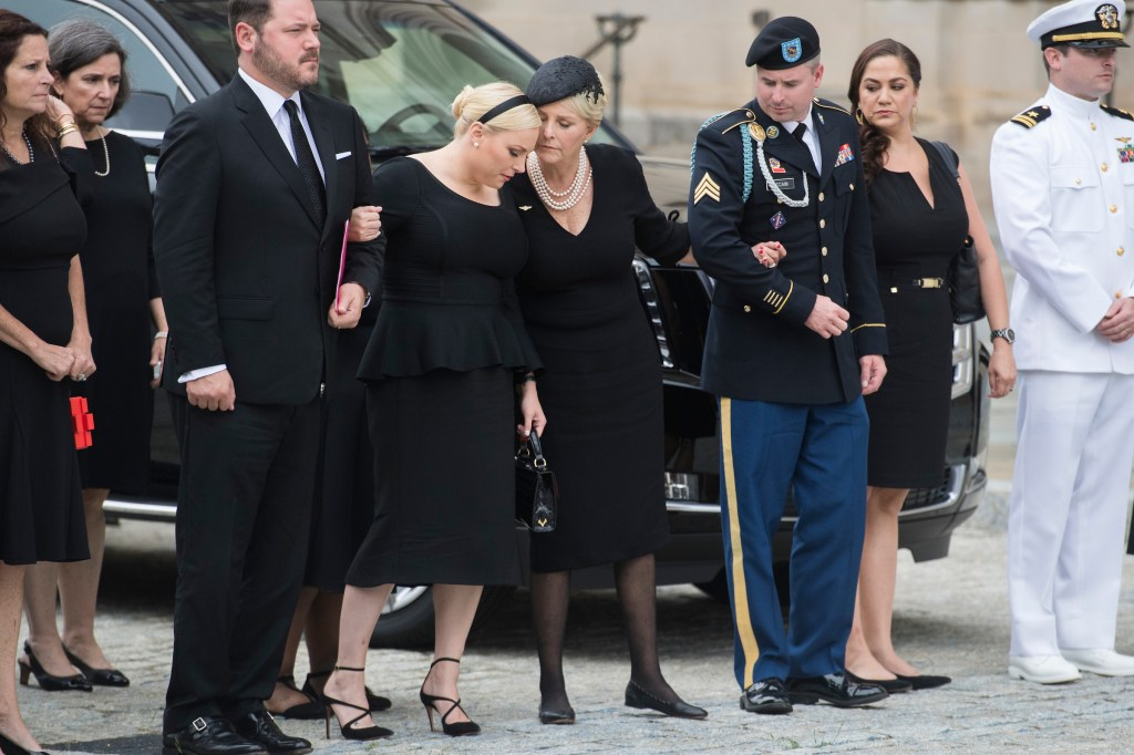UNITED STATES - SEPTEMBER 1: Cindy McCain, wife of the late Sen. John McCain, R-Ariz., their daughter Meghan, sons Jimmy, a Marine, and Jack, a Naval officer, are seen as before the casket of the senator is brought into a ceremony at the Washington National Cathedral on September 1, 2018. (Photo By Tom Williams/CQ Roll Call)