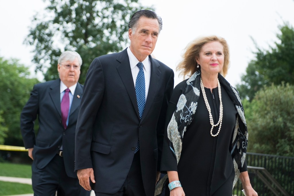 UNITED STATES - SEPTEMBER 1: Mitt Romney and his wife, Ann, arrive for the funeral of the late Sen. John McCain, R-Ariz., at the Washington National Cathedral on September 1, 2018. (Photo By Tom Williams/CQ Roll Call)