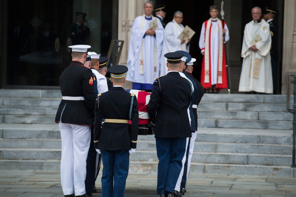 UNITED STATES - SEPTEMBER 1: The casket of late Sen. John McCain, R-Ariz., is brought is into the Washington National Cathedral for his funeral on September 1, 2018. (Photo By Tom Williams/CQ Roll Call)